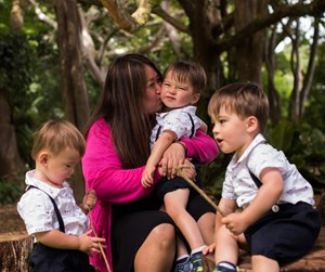 Michelle Kang-Mosher with triplets Michael, Shannon and Samual