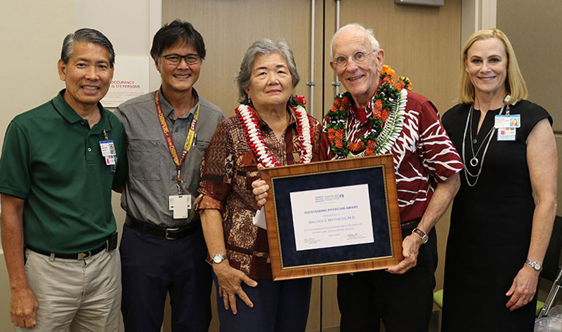 Kapiolani physicians Dr. Loren Yamamoto and Dr. Michael Sia join Dr. Wallace Matthews and his wife and Kapiolani CEO Martha Smith for a special presentation to honor Dr. Matthews with Kapiolani's Outstanding Physician Award.