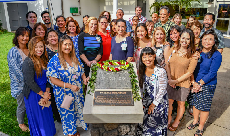 Kapiolani CEO Martha Smith is joined by the medical center's management team at a blessing ceremony for the installation of the commemorative stone that now stands at the main entrance to the medical center