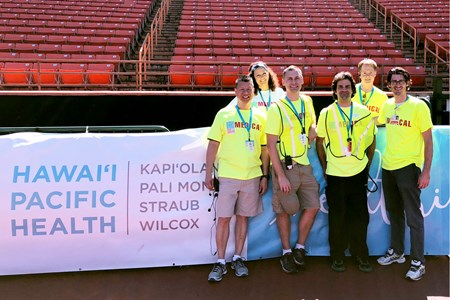 Great Aloha Run Medical Director Dr. Doug Kwock (front row, left) works closely with leads from Hawaii Pacific Health and other community organizations to coordinate medical support along the 8.1-mile course.