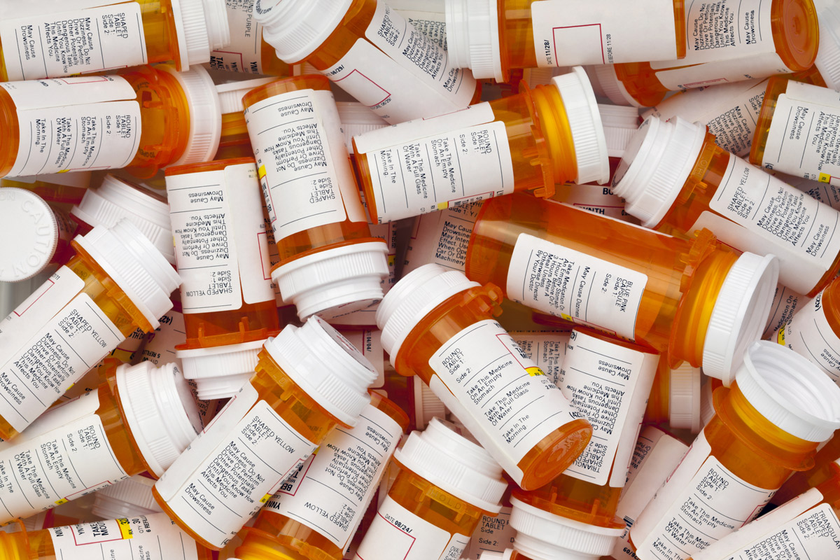 A pile of prescription medication bottles