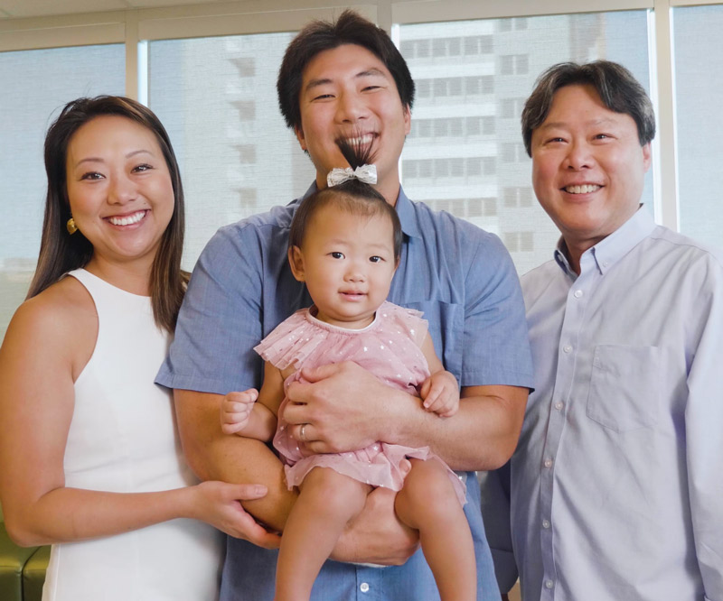 Robert Wada holds daughter Kaila and stands between wife Karen and dad Randy on the third floor of Kapiolani Medical Center's Diamond Head Tower