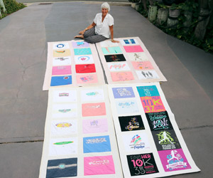 Gerry DeBenedetti sits in her driveway surrounded by her four quilts