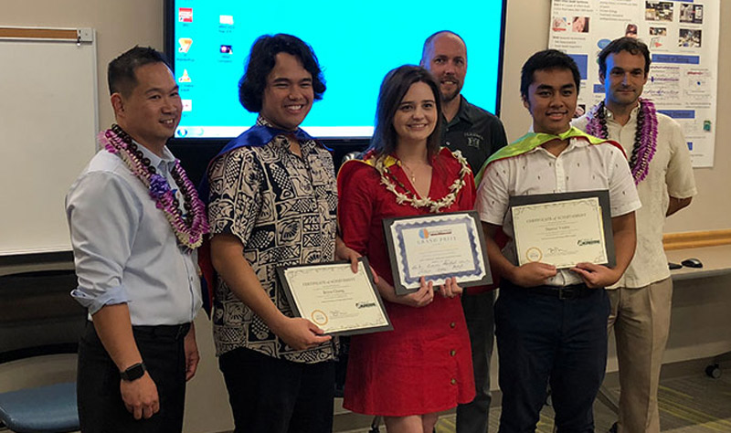 Three MIND Hawaii advisors with winning team of three students holding award certificates