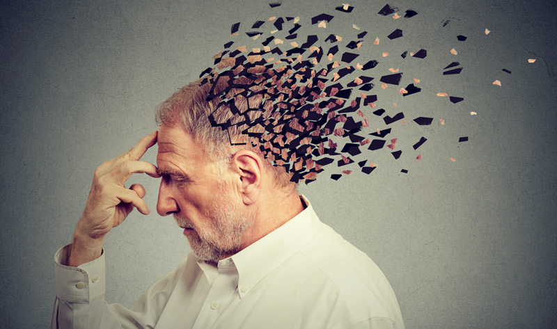 depiction of a man with pieces of his head fading away to represent memory loss