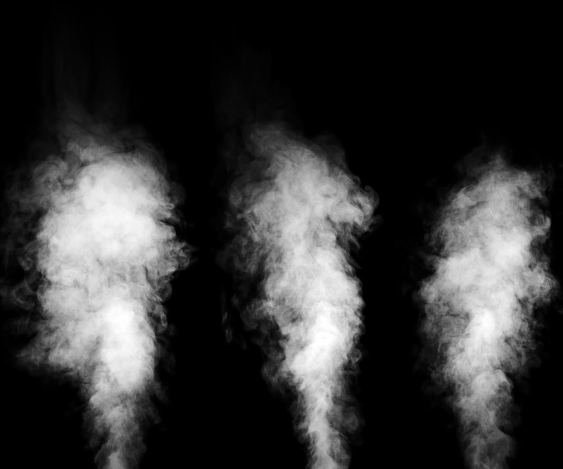three blasts of white steam shoot upward in front of a black background