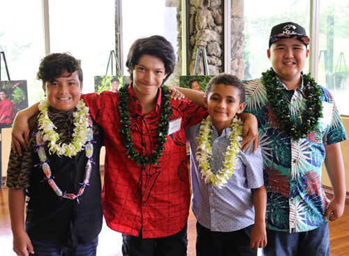 Mahoe Dancel (second from left) stands for a reunion picture with 'Wilcox boys' and fellow Wall of Hope patients (from left) Jayven Alvarez-Hopkins, Bjorn Astrom and Aidan Gadingan. The four boys bonded during their respective inpatient stays at Kapiolani in the Wilcox Unit.
