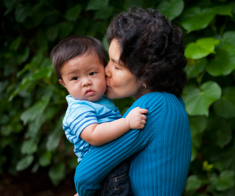Marol Kawada holds and kisses her youngest son, Michael