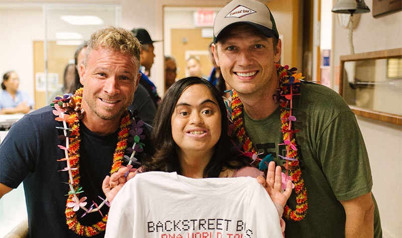 Backstreet Boys members Brian Littrell and Nick Carter with female cancer patient