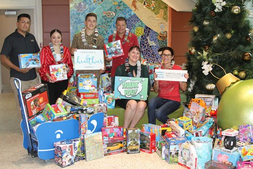 Hawaii businesses and community organizations like JN Group display their generosity each year with a donation to Santa's Workshop.