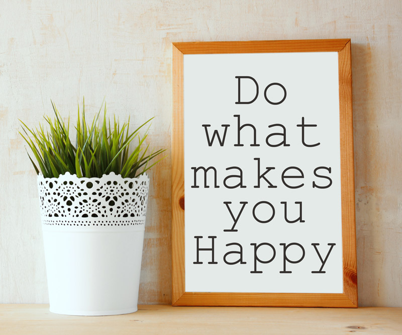 "a framed sign that says ""Do What Makes You Happy"" on a wooden counter top next to a potted succulent"
