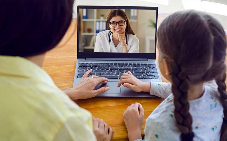 Telehealth doctor on laptop screen