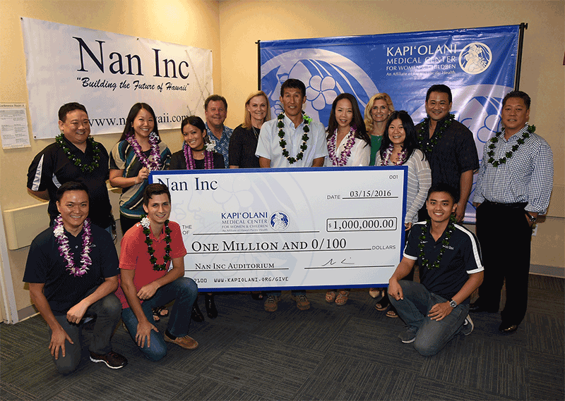 Group taking photo holding cheque from Nan Inc