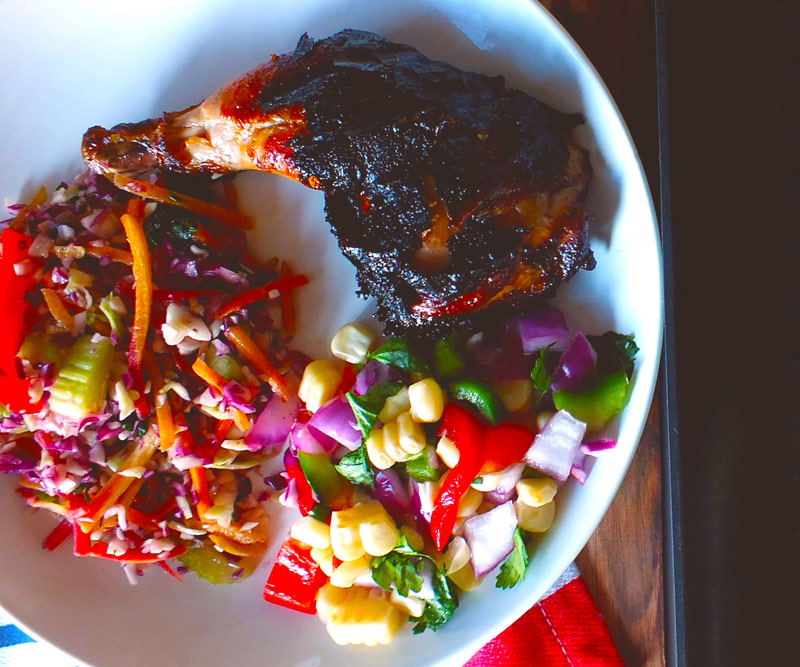 Bowl of Butterflied Cornish Hen with Smoky Balsamic Marinade & Roasted Corn Relish