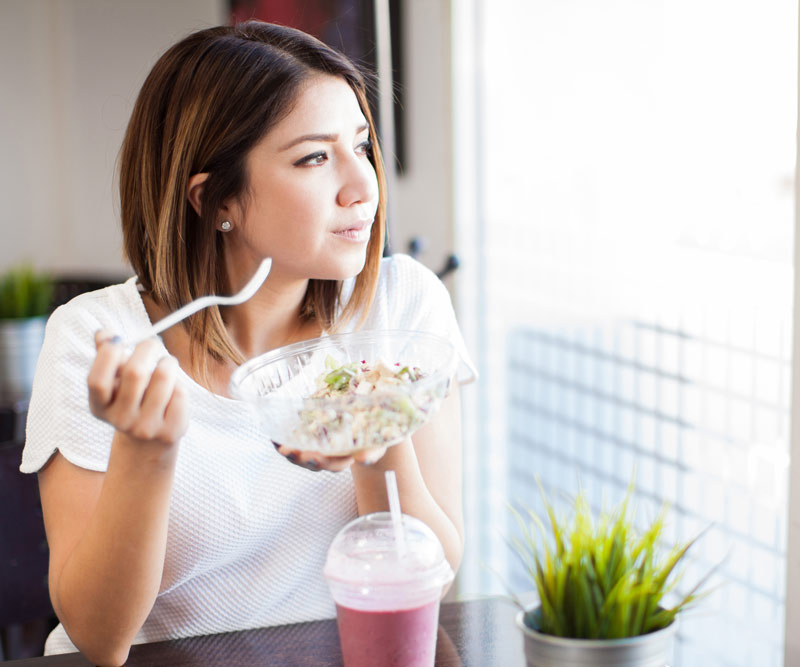 Woman eating a healthy smoothie