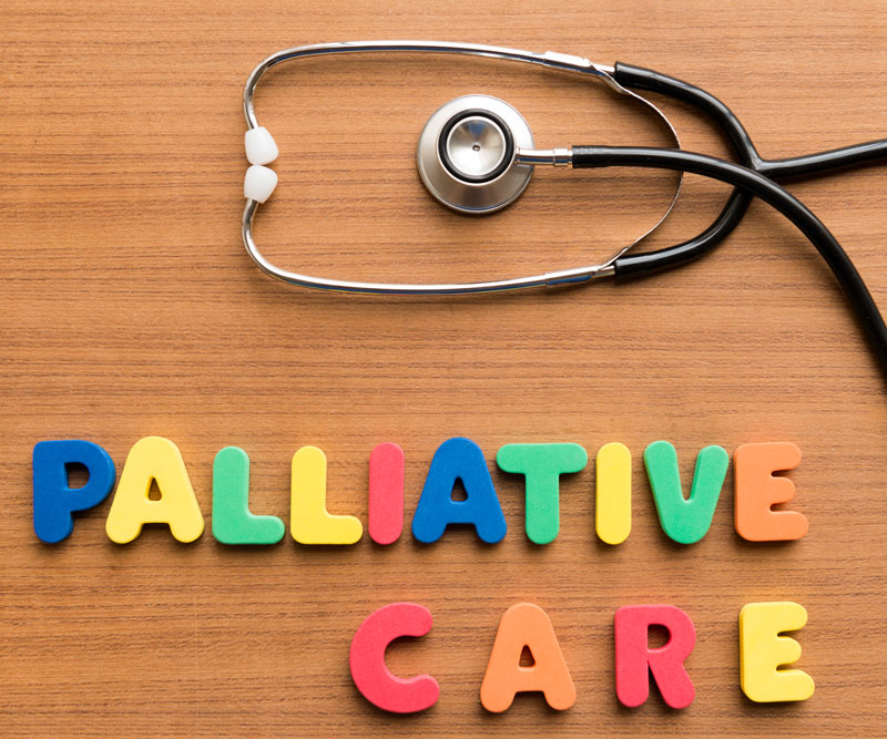 "a stethascope with the words ""palliative care"" spelled out"