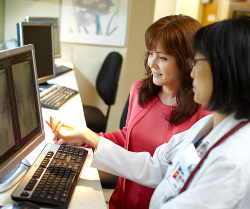 Doctor examining a scan with her patient
