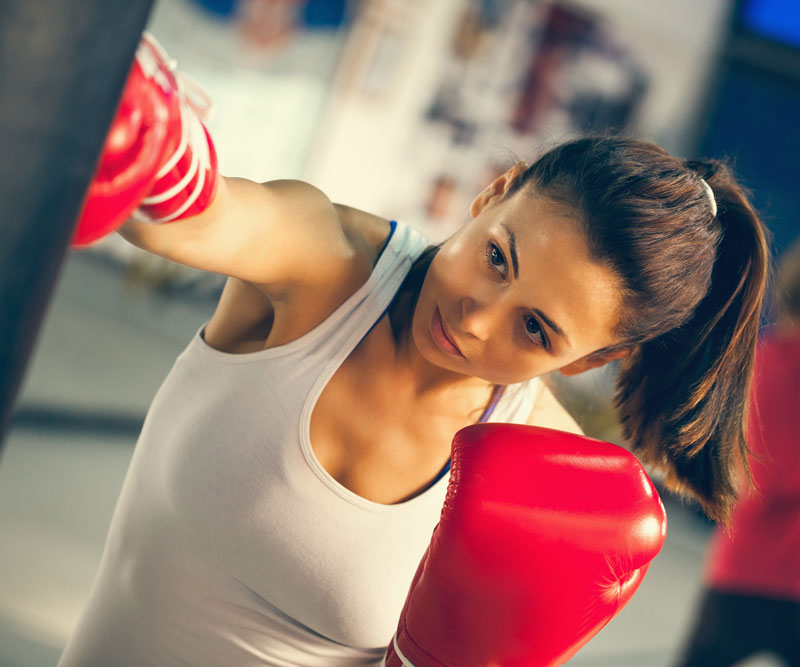 a female boxer punching a bag