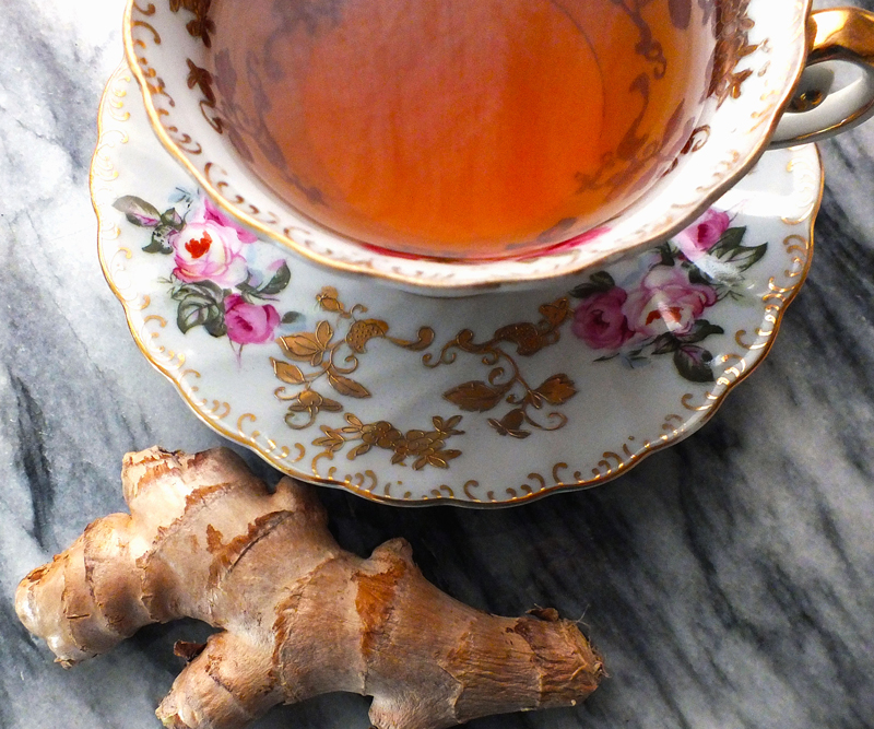 ginger root near a cup of tea