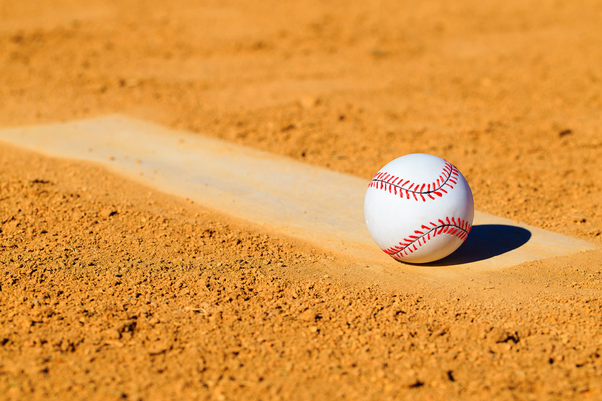 baseball alone in the dirt