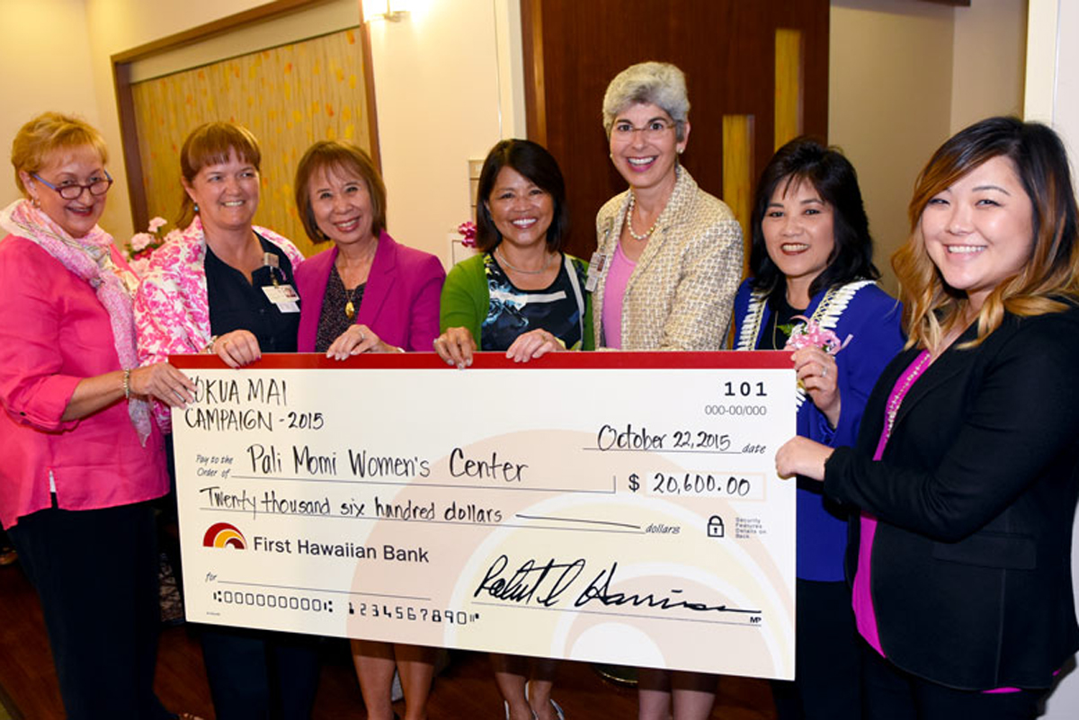 Pali Momi leadership and Women's Center staff holding a check donation from First Hawaiian Bank