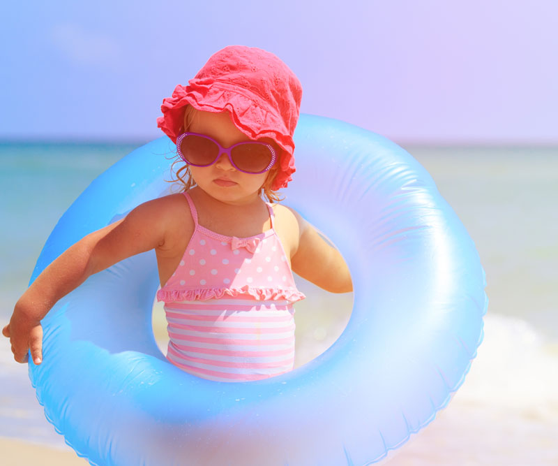 a child holding a flotation device