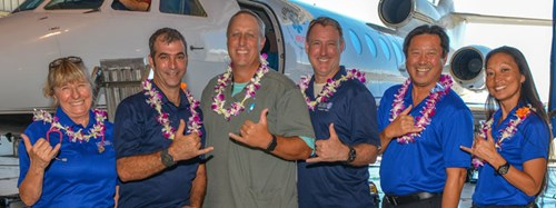 The Kapiolani Critical Care Transport Team flash a shaka at the dedication ceremony for the hospital's new air ambulance.