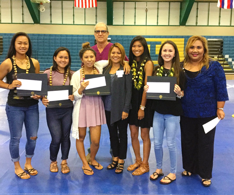 group of high school students with scholarships in hand