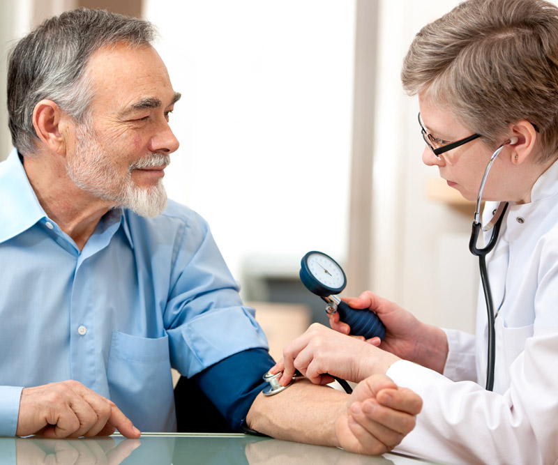 Man getting regular examination from doctor