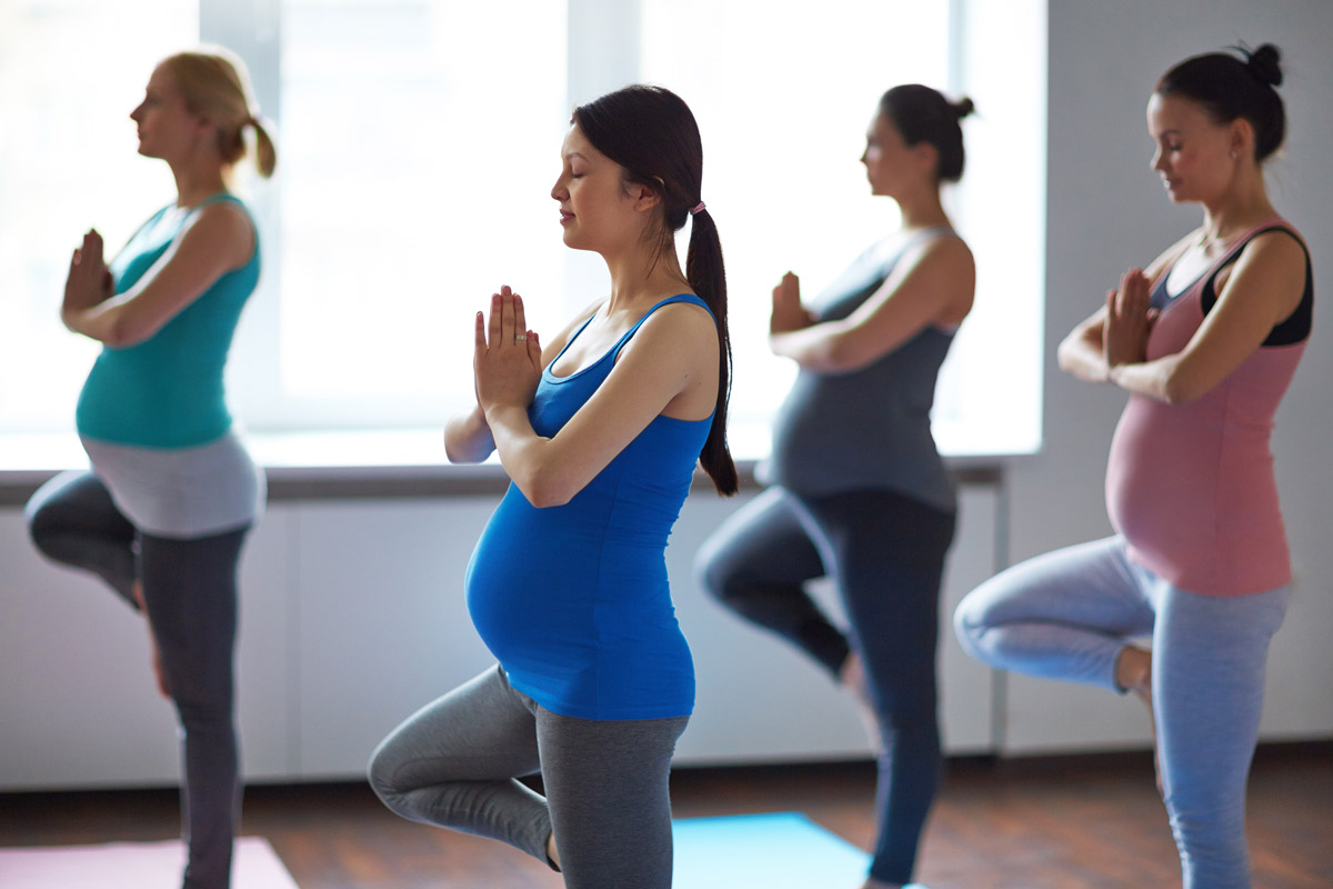 pregnant women doing yoga together