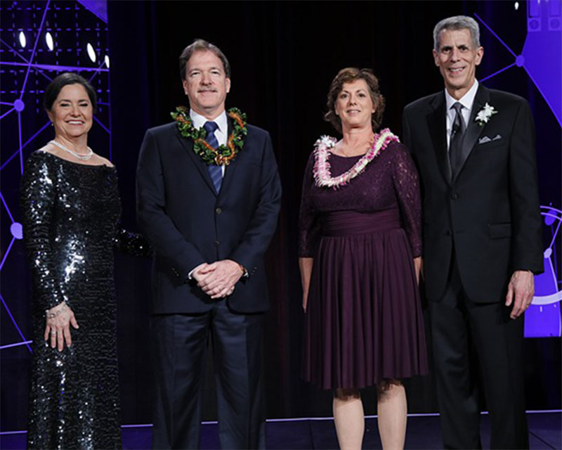 Photo of Hawaii Pacific Health Executive Vice President and Chief Information Officer Steve Robertson (second from left) and Senior Vice President and Chief Quality Officer Melinda Ashton, MD (second from right)
