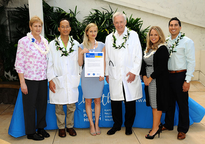 "Dr. Ian Okazaki, Straub oncologist (second from left), and Dr. Donald Saelinger, Straub gastroenterologist (fourth from left) signed the National Colorectal Cancer Roundtable's ""80% by 2018"" commitment pledge on behalf of Straub Medical Center."