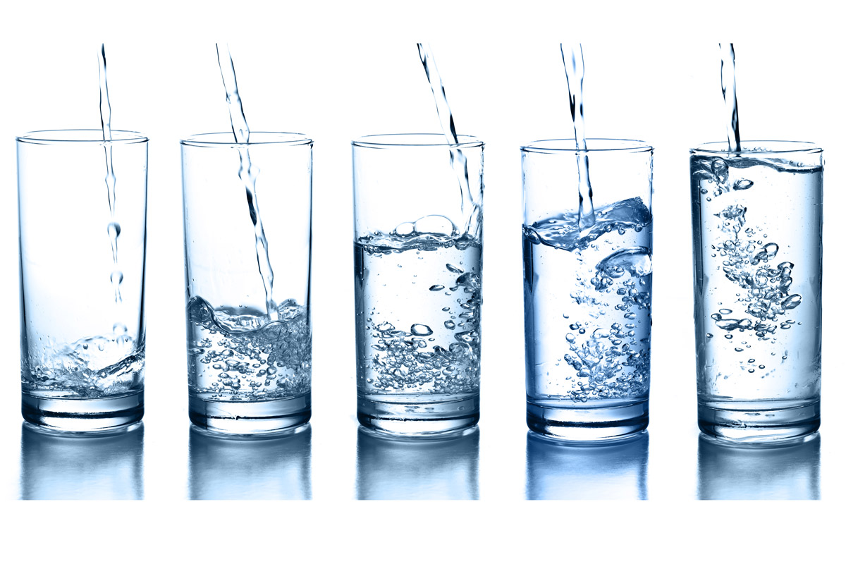 five glasses of water at varying levels