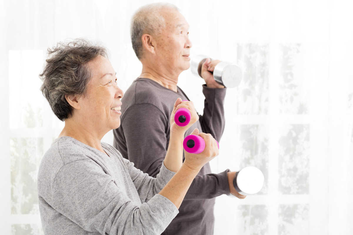 an elderly couple working out together