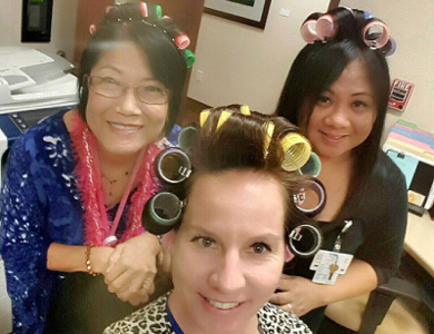Three women wearing hair rollers