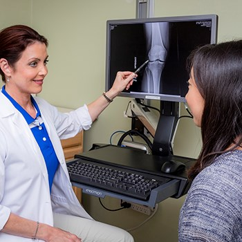 Doctor analyzing a bone scan