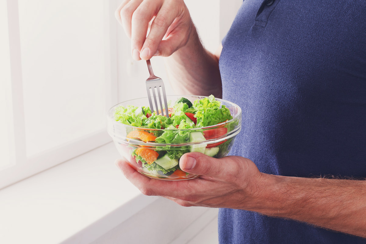 person eating a healthy salad