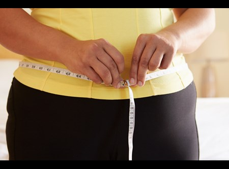 One symptom of metabolic syndrome? Carrying your weight in your midsection. If your waist measures more than 35 inches (for women) or 40 inches (for men), talk with your physician about developing the best weight-loss plan for you.