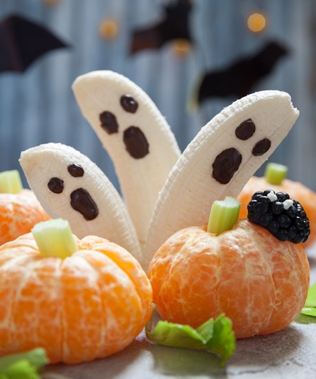 Banana Ghosts and Pumpkin Tangerines carved and prepared for Halloween party.