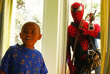 Man dressed as Spider-Man and keiki