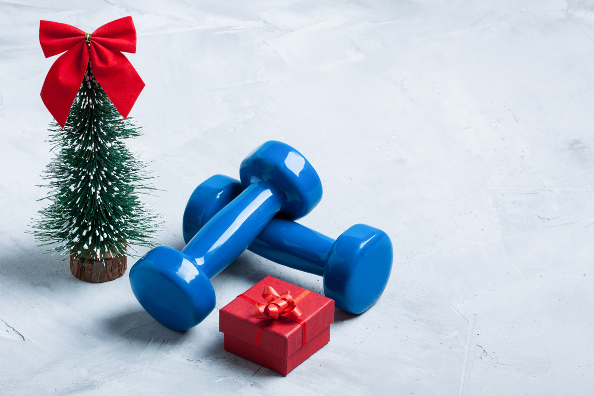 workout gears next to small Christmas tree