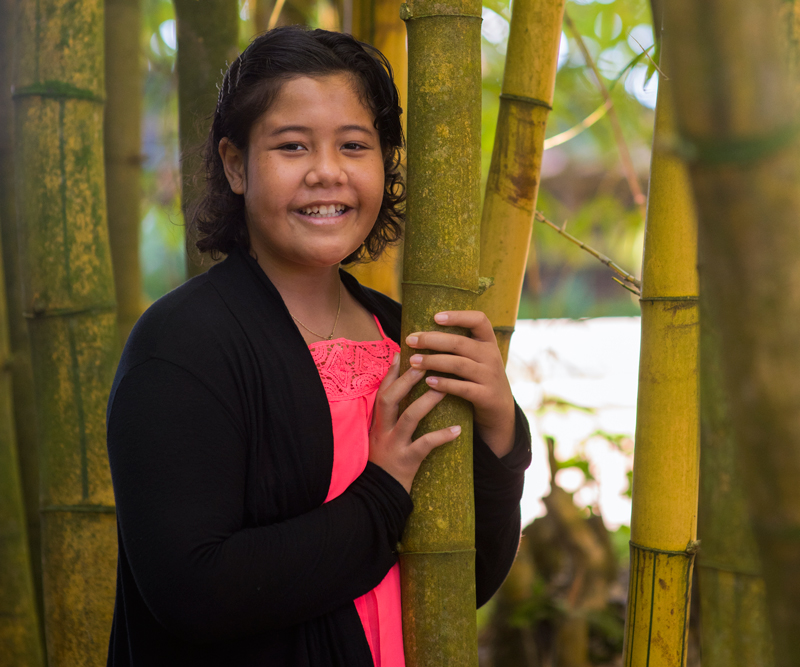 Rachel Ashley Ioane holding on bamboo tree