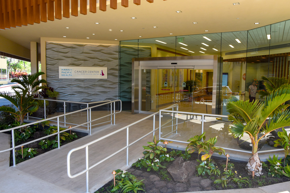 The entry to the Hawaii Pacific Health Cancer Center at Pali Momi Medical Center was designed with patients in mind, from its beautifully landscaped walkway to to large glass doors to let in natural light wheelchair ramp for easy accessibility.