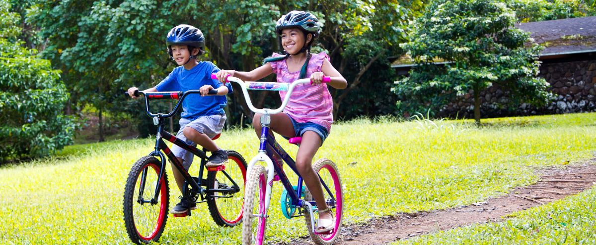 two children riding their bicycles together