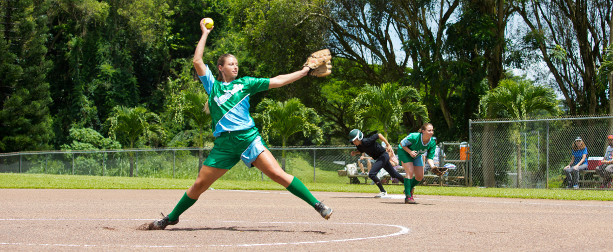 girl pitching a softball