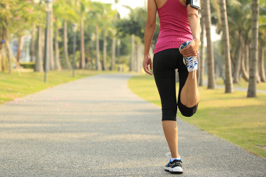 Woman stretching her legs before her run