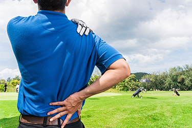 Golfer clutching sore back