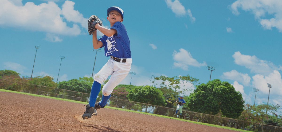 Image of a boy pitching a baseball