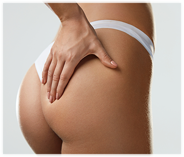 Buttocks of a women wearing a white thong