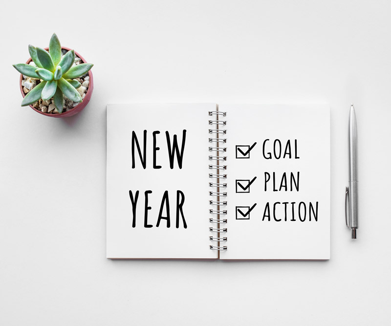 Planner with a checklist of goals, plan and action for the New Year